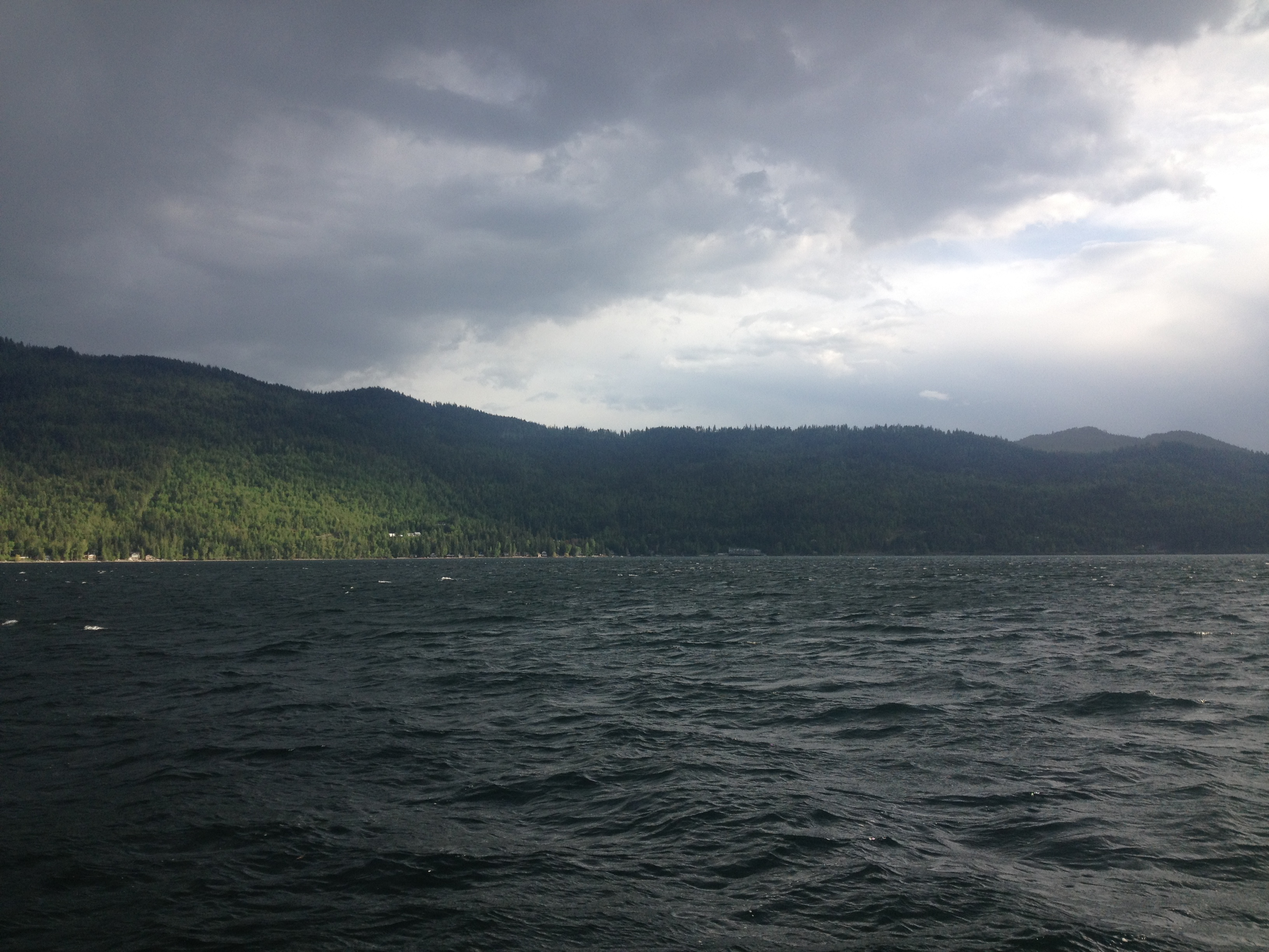 Sun shines through the storm clouds on the Shuswap
